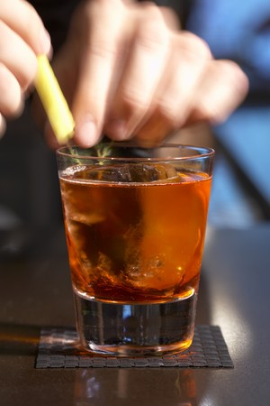 barkeep: Person Adding Garnish to a Glass of Negroni Sbagliato
