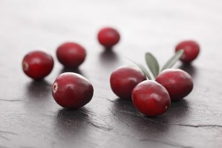 vaccinium macrocarpon: Cranberries on a slate surface