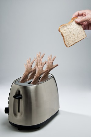 several breads: Four Hands Reaching From a Toasted to Grab a slice of Bread LANG_EVOIMAGES