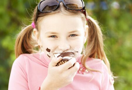 10 to 12 year olds: A girl eating a chocolate marshmallow