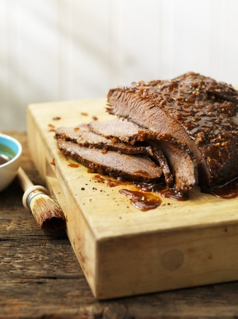 qs: Grilled and marinated beef brisket, sliced