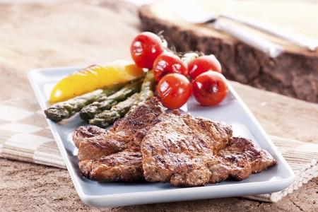 qs: Grilled pork collar steak with a side of vegetables