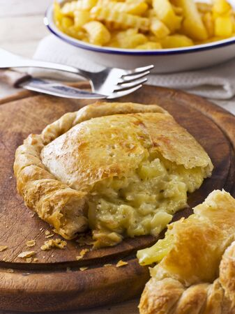 pasty: Cheese and onion pasty, cut LANG_EVOIMAGES