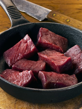cubed: Cubed venison in frying pan