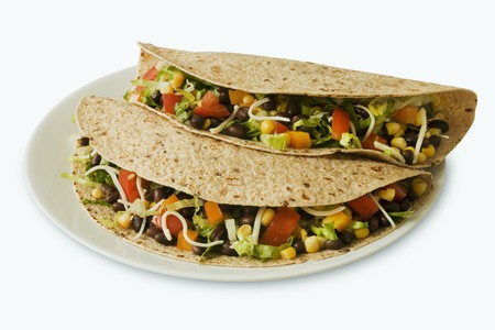 tortillas: Two Vegetarian Tacos on Multi-Grain Tortillas; White Background