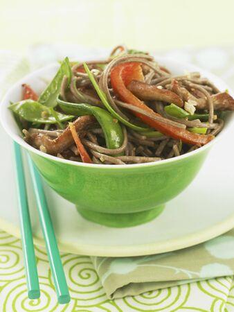 soba noodles: Pork and Veggie Stir Fry Over Soba Noodles in a Green Bowl with Chopsticks