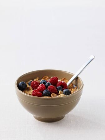 cornflakes: Cornflakes with raspberries and blueberries