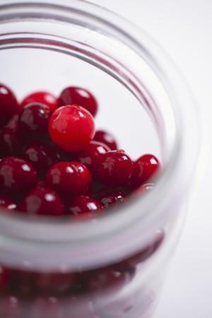 vaccinium macrocarpon: A jar of cranberries