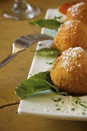 vintage: Deep Fried Risotto Balls on a Platter with Parmesan Cheese LANG_EVOIMAGES