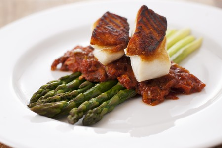 qs: Grilled Halibut and Tomato Bacon Stew On Asparagus Spears
