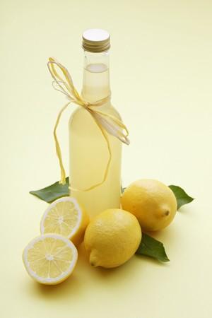 soda pops: A bottle of lemonade and fresh lemons
