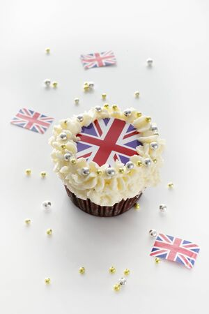 uk cuisine: A cupcake topped with cream and a Union Jack