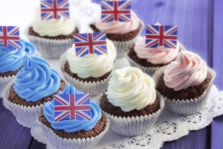doiley: Chocolate cupcakes decorated with coloured cream and Union Jacks