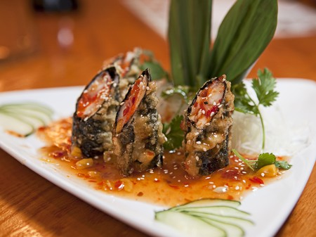 tunafish: Tuna and Salmon Tempura Seaweed Wraps in a Sesame Sauce on a White Plate LANG_EVOIMAGES