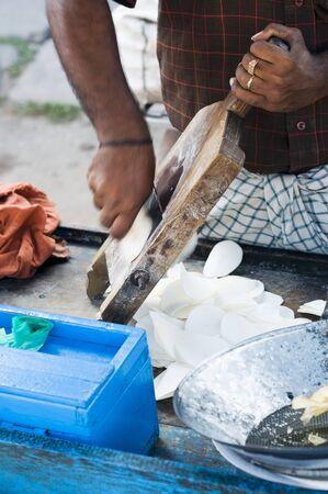 waist deep: An Indian street vendor preparing potato chips LANG_EVOIMAGES