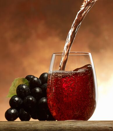 and grape juice: Pouring grape juice into a glass
