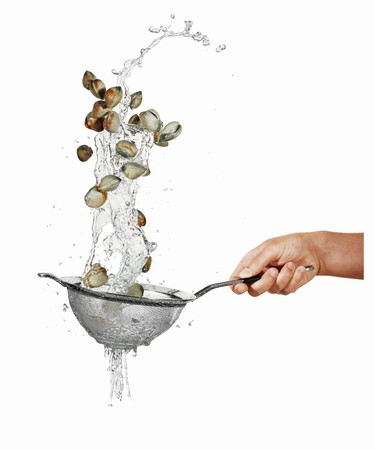 squirted: Washing mussels in a sieve