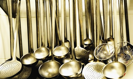 aaa: Ladles and strainer spoons in a large kitchen LANG_EVOIMAGES