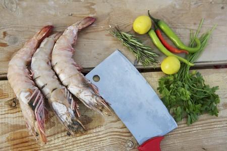 jumbo shrimp: Jumbo shrimp, chili peppers, herbs, lemons and cleaver LANG_EVOIMAGES