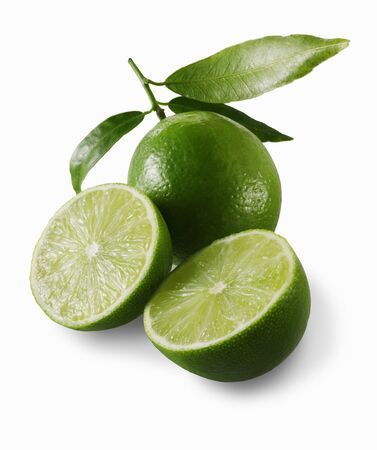 twos: Two lime halves in front of a whole lime