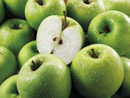 granny smith: Granny Smith apples, whole and halves(fills the screen)