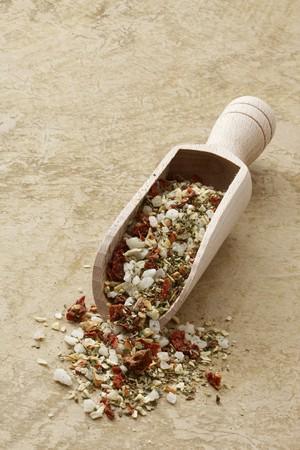 petroselinum sativum: Mediterranean spiced mixture in a wooden scoop