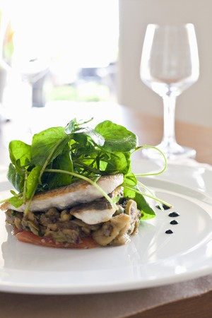 water cress: Sea bass on a bed of vegetables with water cress