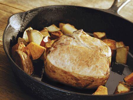 karaj: Pork Chop and Potatoes in a Cast Iron Skillet LANG_EVOIMAGES