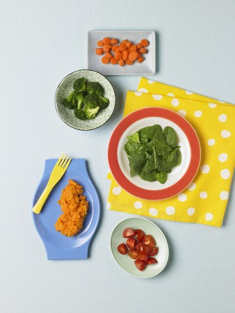 carotene: Assorted Vegetables Containing Beta Carotene: Baby Spinach, Broccoli, Grape Tomatoes, Sweet Potatoes and Carrots