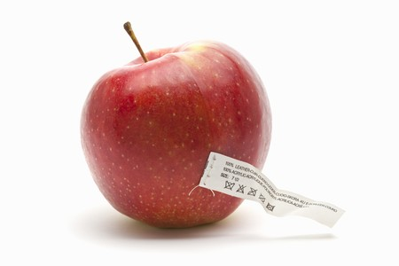 synthetically: An apple with a care label (an icon for synthetically created food) LANG_EVOIMAGES
