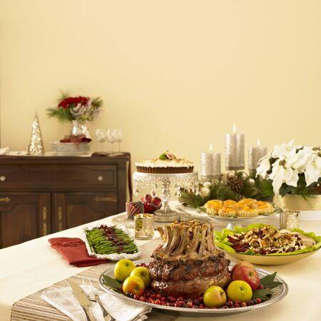 vaccinium macrocarpon: Christmas Dinner Table with Crown Roast Pork