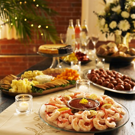 Shrimp Cocktail Platter on a Table with Assorted Party Platters LANG_EVOIMAGES