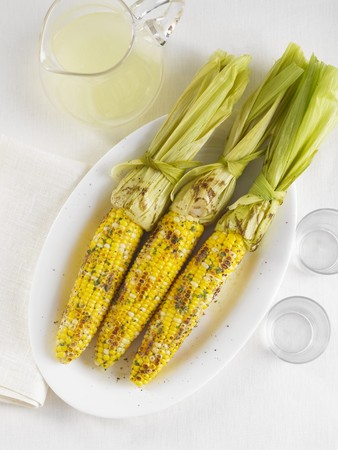 Three Ears of Grilled Corn on the Cob with a Pitcher of Lemonade