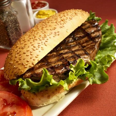 sesame seed bun: Grilled Steak Sandwich on a Sesame Seed Bun with Lettuce LANG_EVOIMAGES