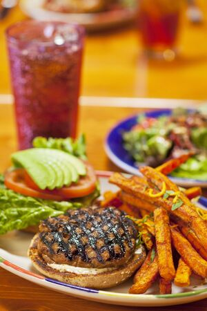 soda pops: Grilled Turkey Burger with Sweet Potato Fried and a Soda