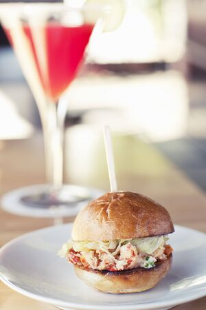 glass topped: Lobster Sandwich Slider on a Roll LANG_EVOIMAGES