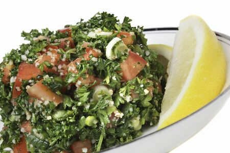 cuisines: Bowl of Fresh Tabouleh with Lemon Wedges LANG_EVOIMAGES