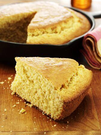 cornbread: Slice of Corn Bread Cooked in a Cast Iron Skillet