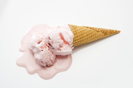 Strawberry Ice Cream Cone Melting on a White Background