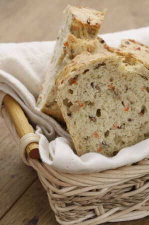 several breads: Slices of carrot bread in a bread basket LANG_EVOIMAGES