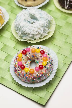 dragees: Frosted Doughnut with Sprinkles and Candies;Assorted Doughnuts