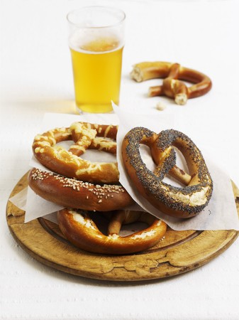 lye: Various lye bread pretzels and a glass of beer LANG_EVOIMAGES
