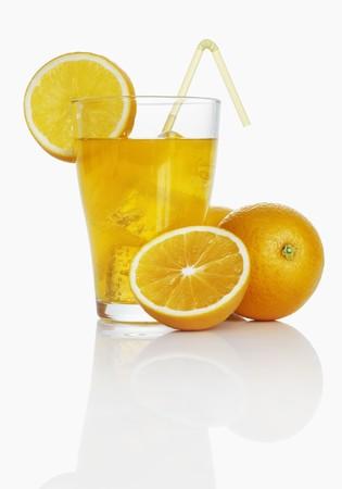 soda pops: Orangeade and fresh oranges LANG_EVOIMAGES