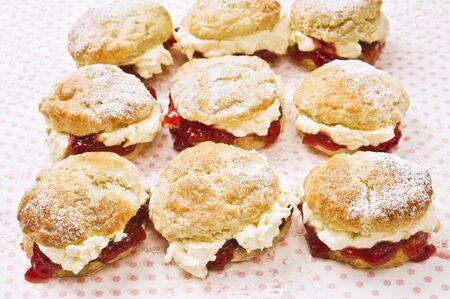 uk cuisine: Nine scones with raspberry jam and cream
