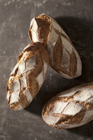several breads: Three loaves of country bread LANG_EVOIMAGES