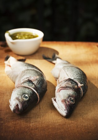 worktops: Two Whole Branzino Fish Stuffed with Lemon, Thyme and Butter LANG_EVOIMAGES