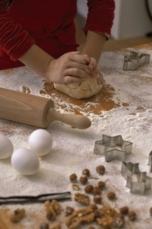 worktops: A child kneading biscuit dough on a floured work surface