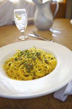 petroselinum sativum: Spaghetti with Capers in a Butter Garlic Sauce; In a White Bowl