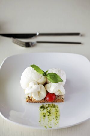 topped: Toast topped with mozzarella balls LANG_EVOIMAGES