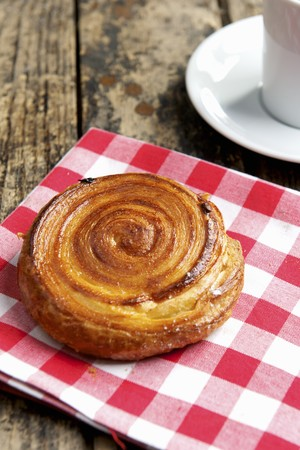 danish puff pastry: A puff pastry spiral on a checked cloth